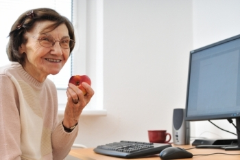 older woman at computer